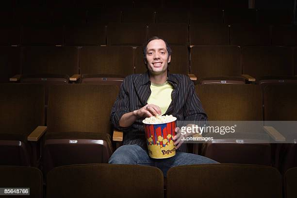 Man sitting in movie theatre