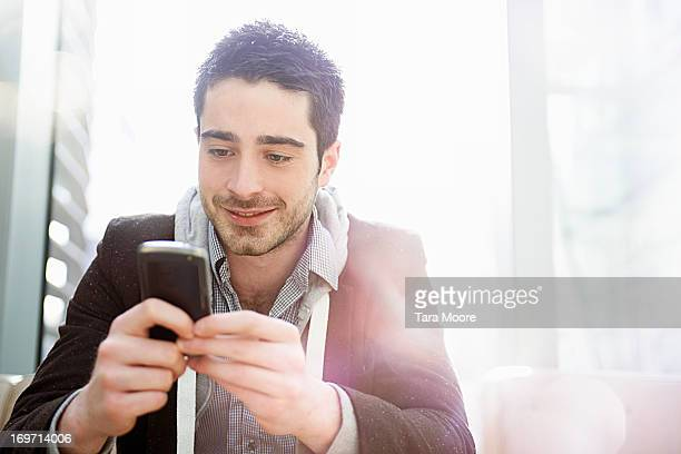man sitting in office looking at mobile phone