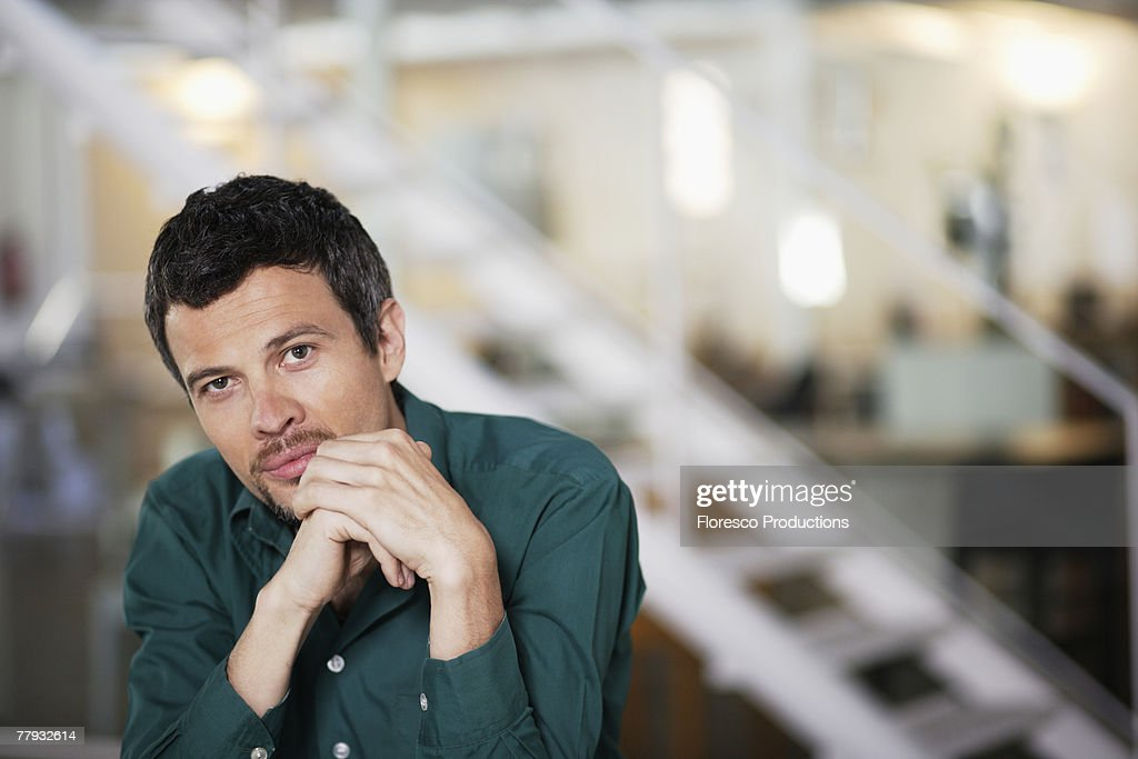 Man sitting in office : Stock Photo