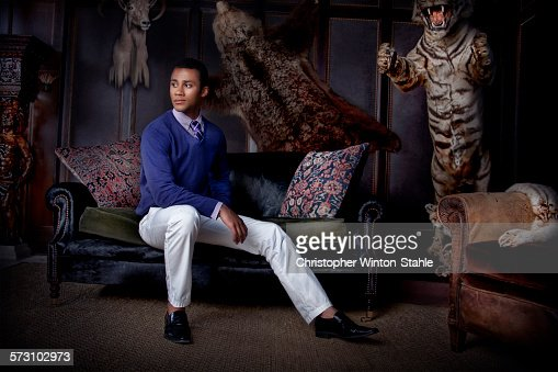 Man sitting in parlor with stuffed animals