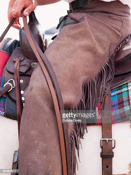 man sitting in saddle