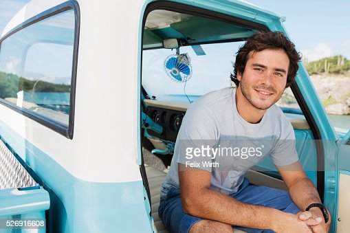 Man sitting in truck and smiling : Photo