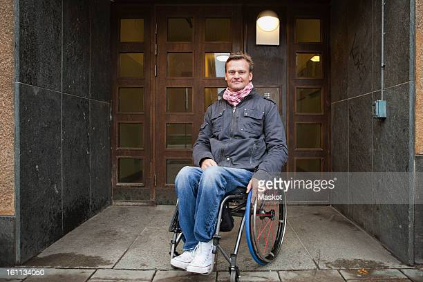 Man sitting in wheelchair looking at camera