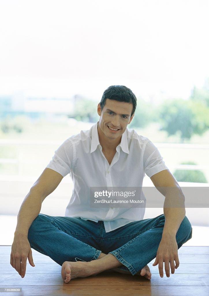 Man sitting indian style on floor
