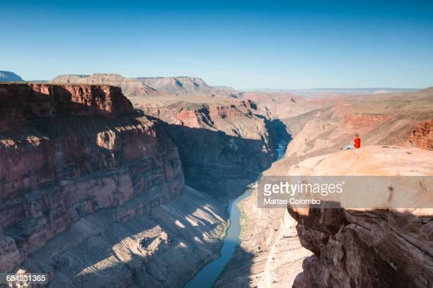 Man sitting near the edge, Grand Canyon, USA
