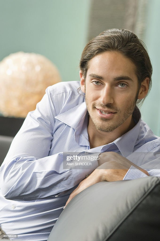 Man sitting on a couch : Stock Photo