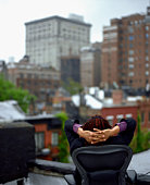 Man sitting on a rooftop