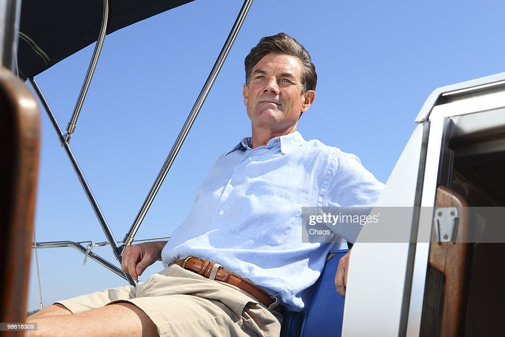 Man sitting on a Sailboat