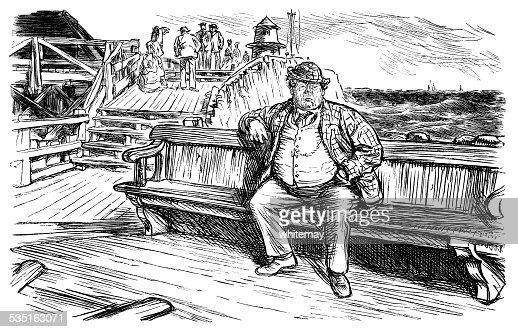 Man sitting on a seaside bench
