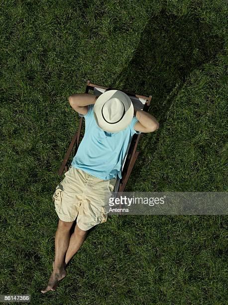 A man sitting on a sun lounger