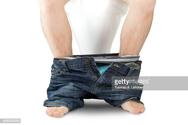 Man sitting on a toilet seat