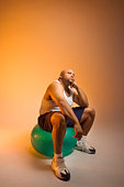 Man sitting on a yoga ball