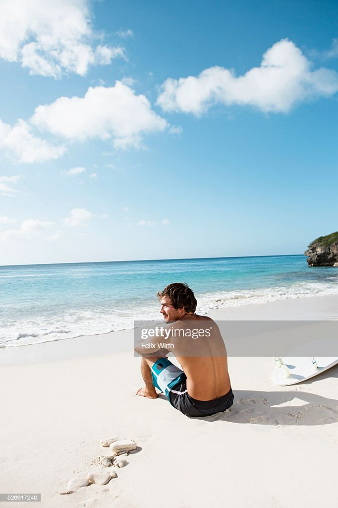 Man sitting on beach : Stock Photo