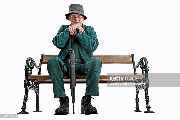 Man sitting on bench, close-up