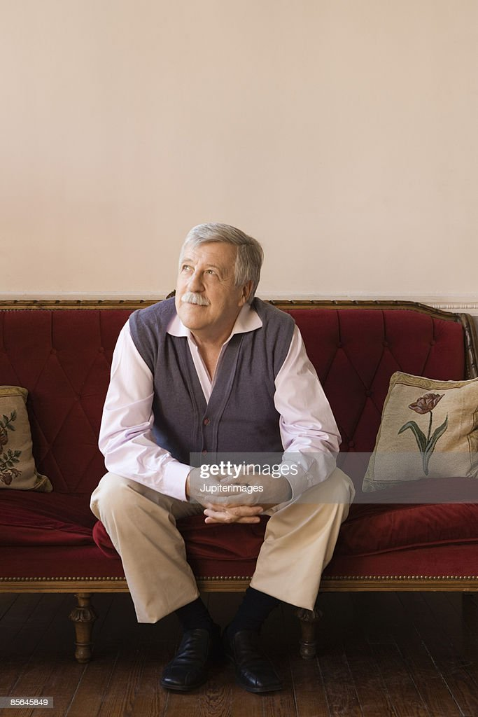 Man Sitting On Couch Stock Photo | Getty Images