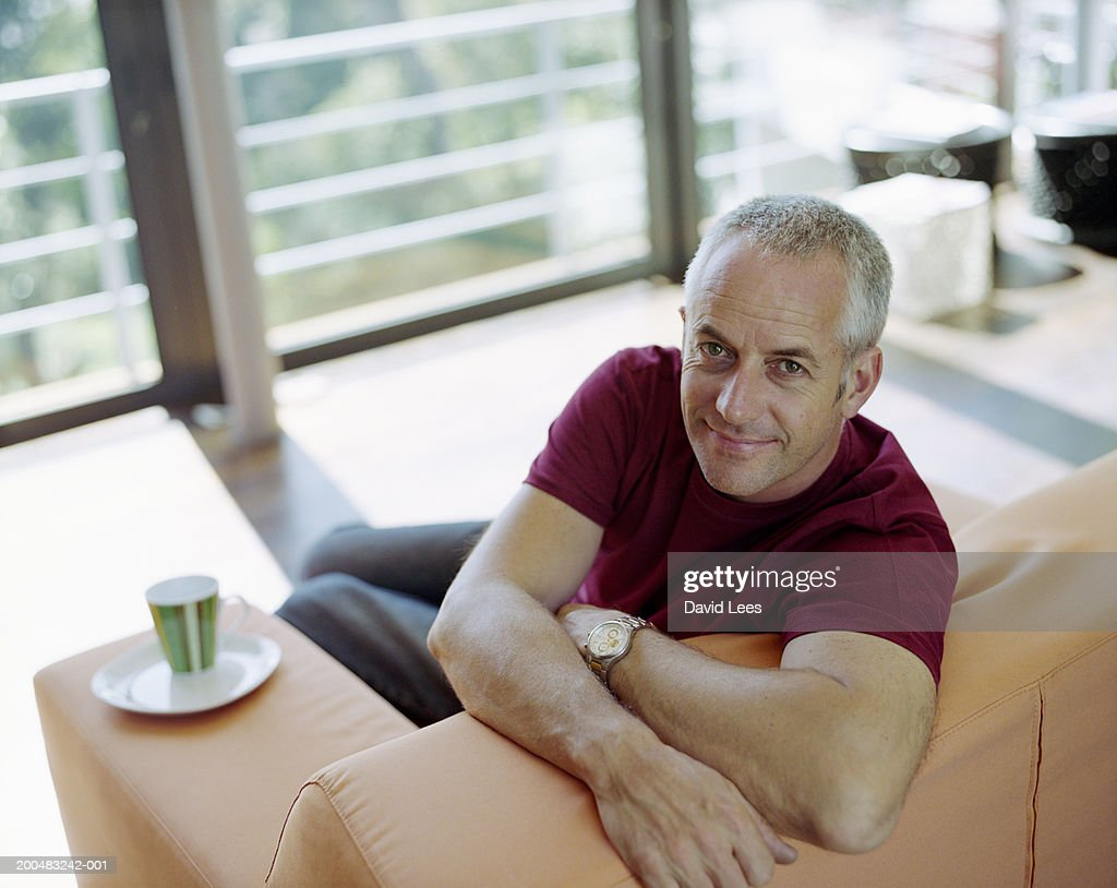Man sitting on couch, portrait, elevated view