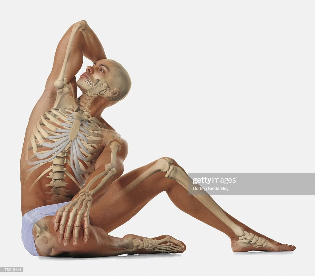 Man sitting on floor with one hand behind head, other hand on his knee, looking up, illustration of his skeleton overlaid. : Stock Photo