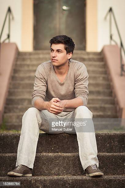 Man sitting on front steps