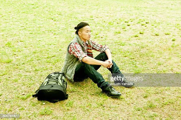 Man sitting on grass field