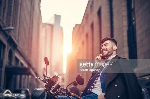 Man sitting on motor bike