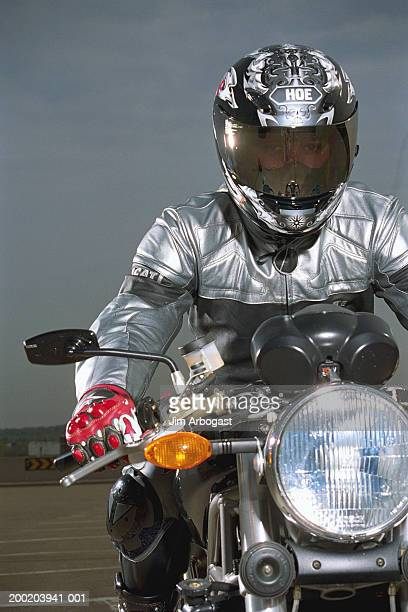 Man sitting on motorcycle, portrait
