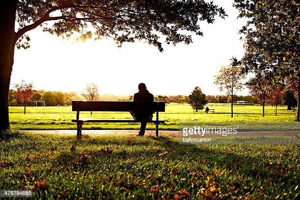 Man sitting on park bench