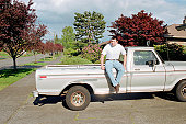 Man sitting on pick-up truck