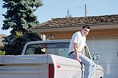Man sitting on pick-up truck