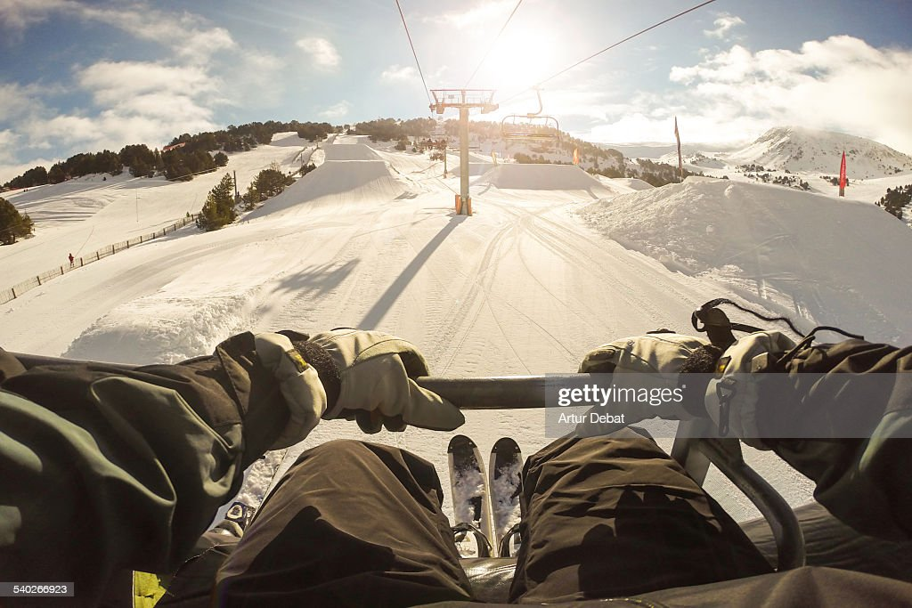 Man sitting on ski lift in the Pyrenees from pov. : Stock Photo