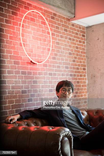 Man sitting on sofa, portrait