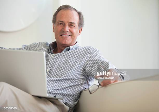 Man sitting on sofa with laptop