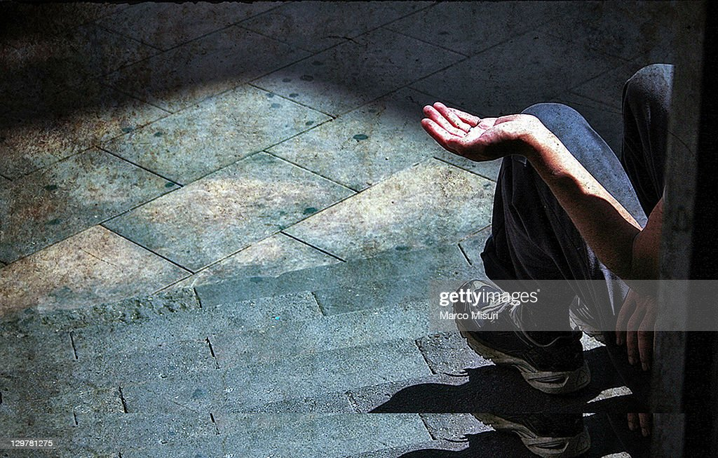 Man sitting on staircase : Stock Photo