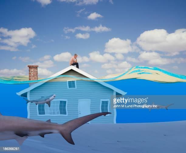 Man sitting on underwater house