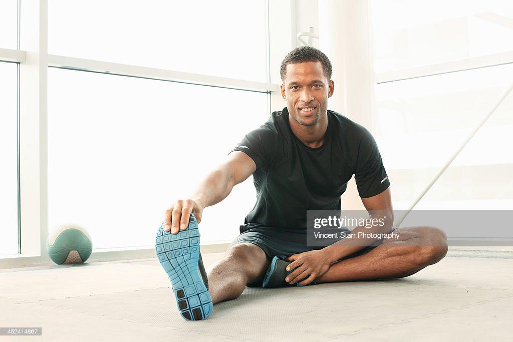 Man sitting touching toes stretching