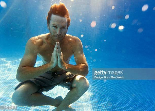 A Man Sitting Underwater In A Meditation Pose