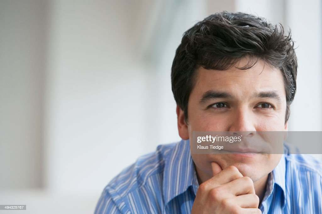 Man sitting with chin in hands