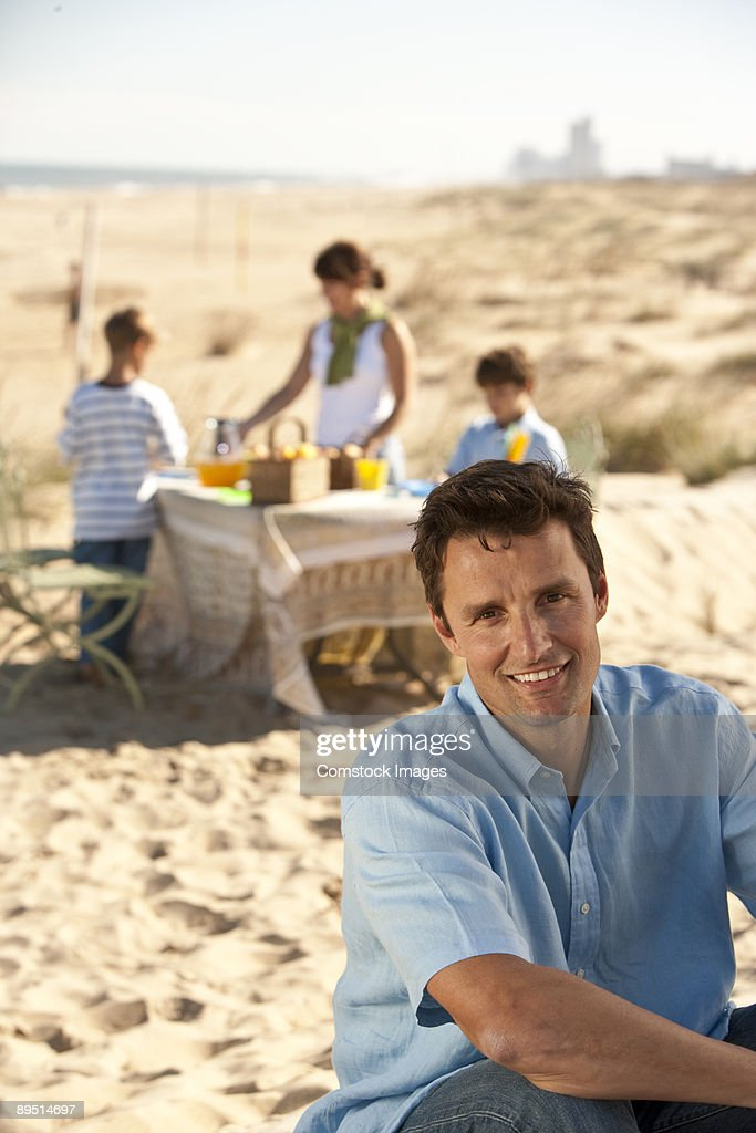 man sitting with family : Stock Photo