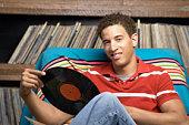 Man sitting with record album