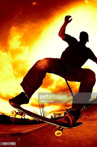 Man Skateboarding at Skatepark on Red Sky Background