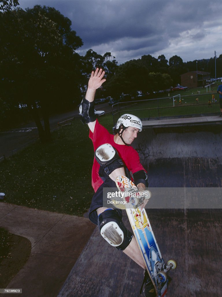 Man skateboarding on ramp : Stock Photo