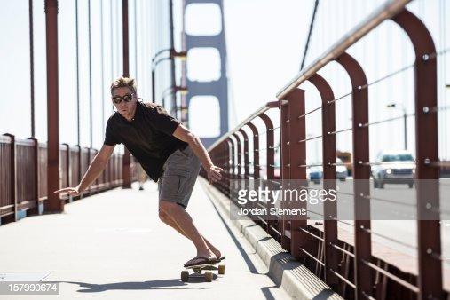 A man skateboarding on the Golden Gate. : Stock Photo