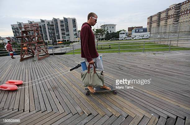 A man skateboards at Rockaway Beach on August 19 2012 in the Queens borough of New York City Over the last few years the Rockaways peninsula has...