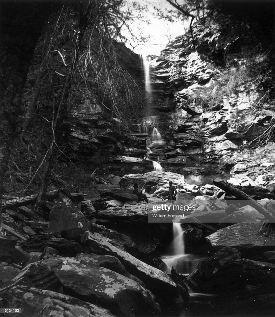 A man sketching by a waterfall in the Kaaterskill Glen in the Catskill Mountains New York State