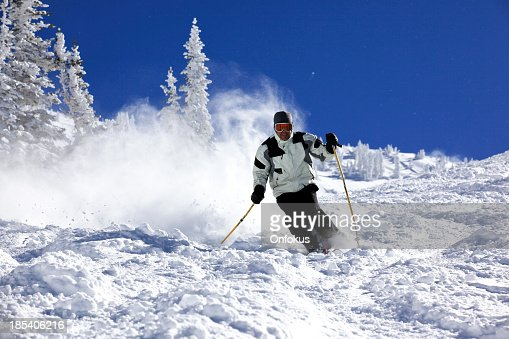 Man Skier in Action in Powder Snow With Clear Sky