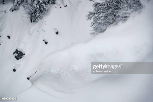 Man skiing in deep powder snow, Gosau, Gmunden, Austria