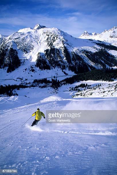 Man skiing in Lech, Austria.
