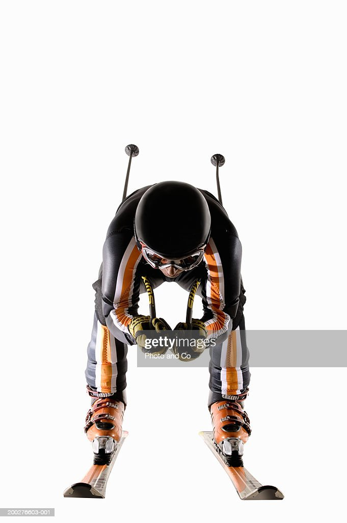 Man skiing on snow covered slope : Stock Photo