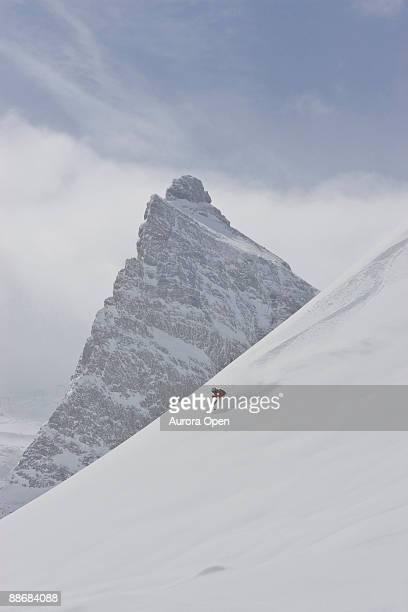 A man skis in fresh, deep, untracked powder at a resort in the Zillartal Valley, Austria.