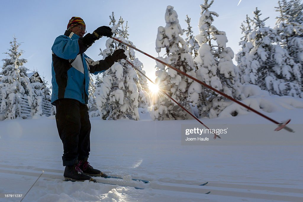 A man skis through a snowy forest on December 7, 2012 in Altenberg, Germany. A low pressure system dumped snow on the south and east of the country before heading west.