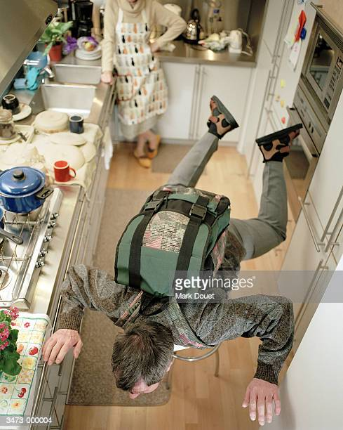 Man Skydiving in Kitchen